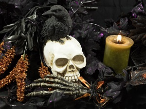 Halloween decorations including a lit candle which can be dangerous.