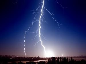 Lightning against a dark blue sky.