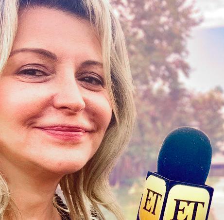 Lisa Steinmetz with Entertainment Tonight mic