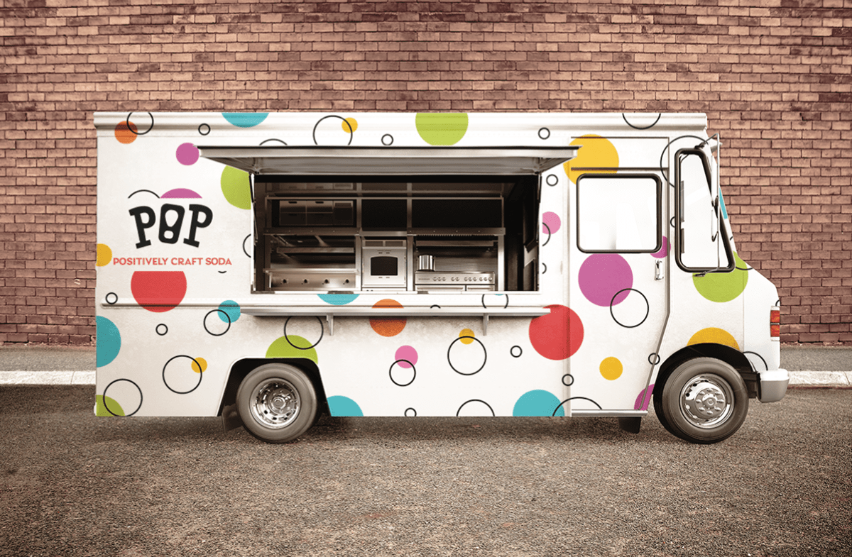 Pop food truck outside of a brick building