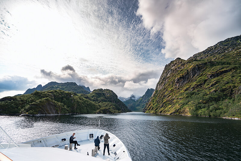 A group see the almost uninhabited Lonkan Fjord in Norway while on a chartered superyacht