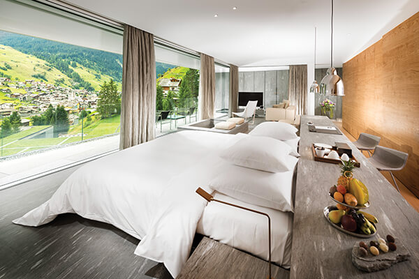 The top-floor suites of hotel 7132, designed by Japanese architect Kengo Kuma, offer breathtaking views of the Swiss Alps