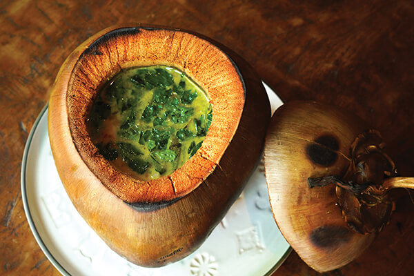 Daun Kelor Mesanten, cooked and served in a coconut from Locavore in Ubud, Bali