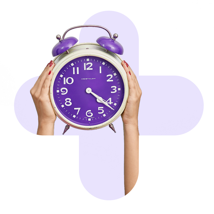Two females hands holding alarm clock
