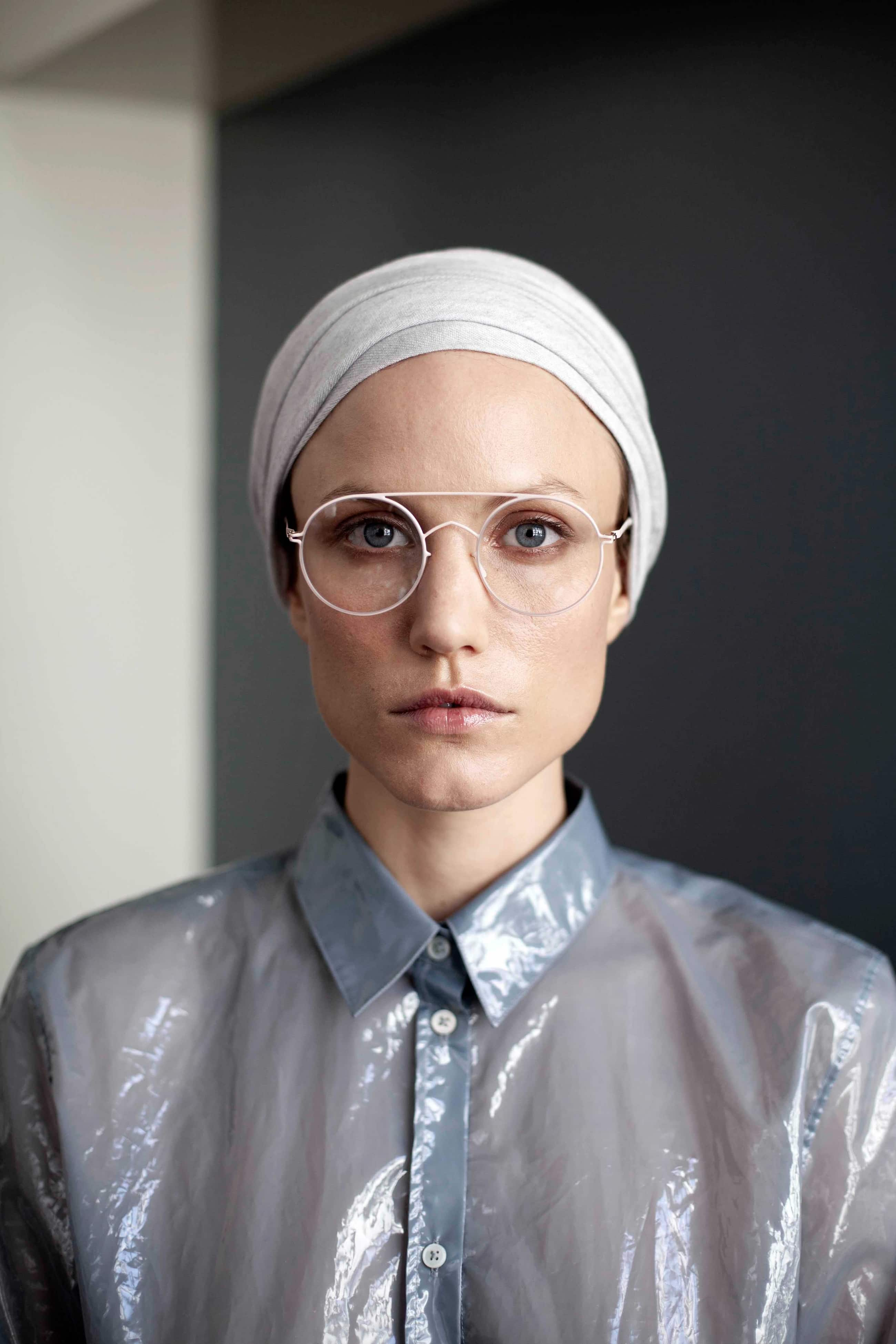 Portrait of woman with glasses.