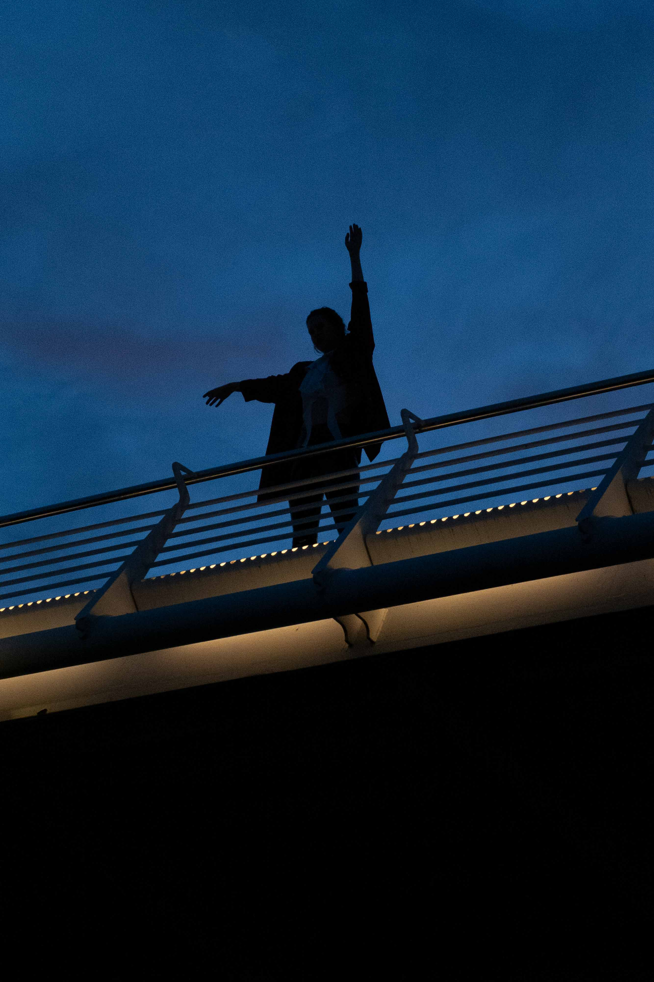 Artistic image of bridge and woman.