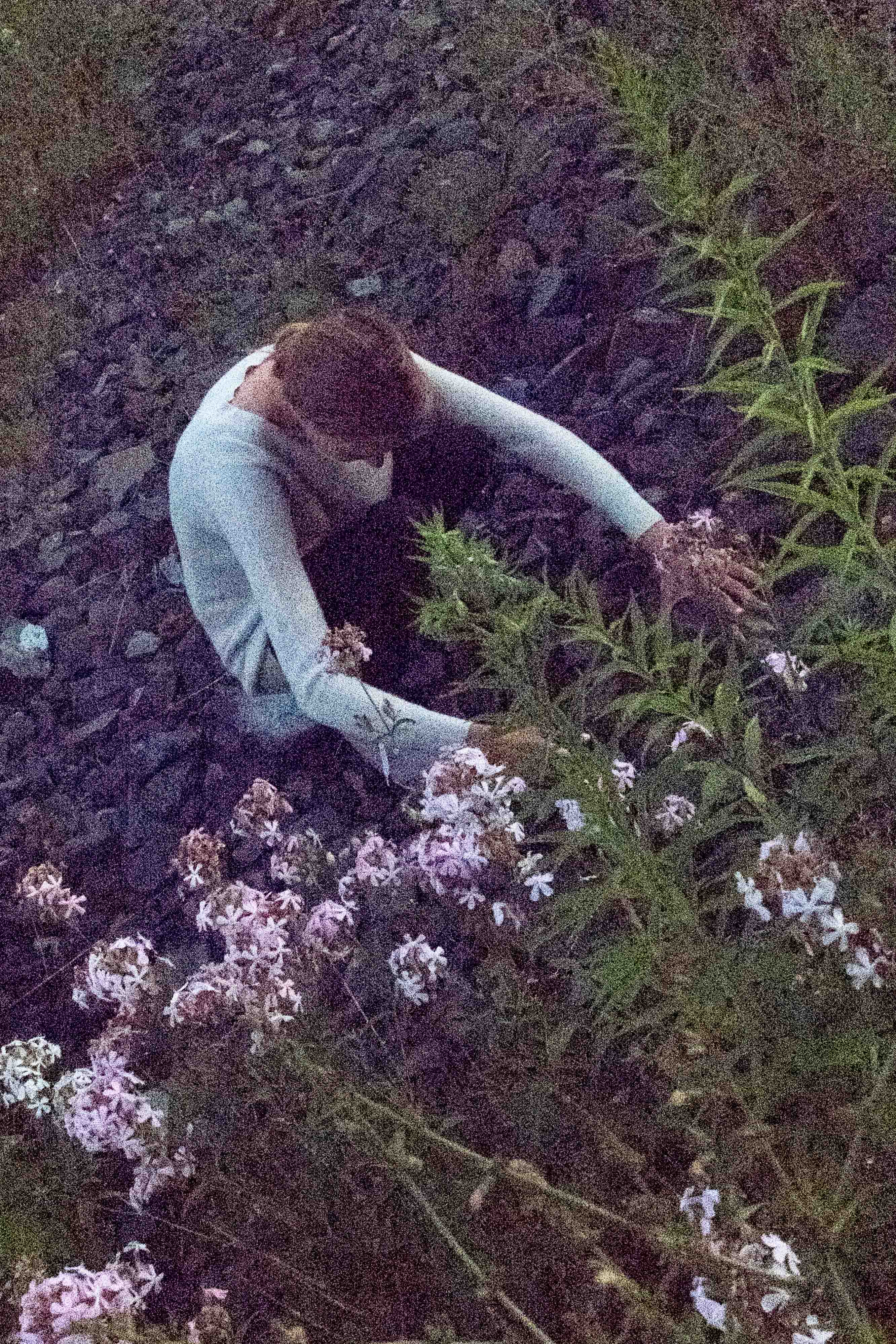 Woman kneeing down on stone ground.