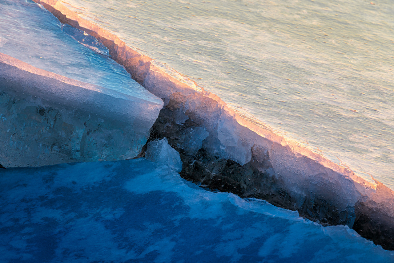 What appears to be a large mass of ice with a gigantic crack in it