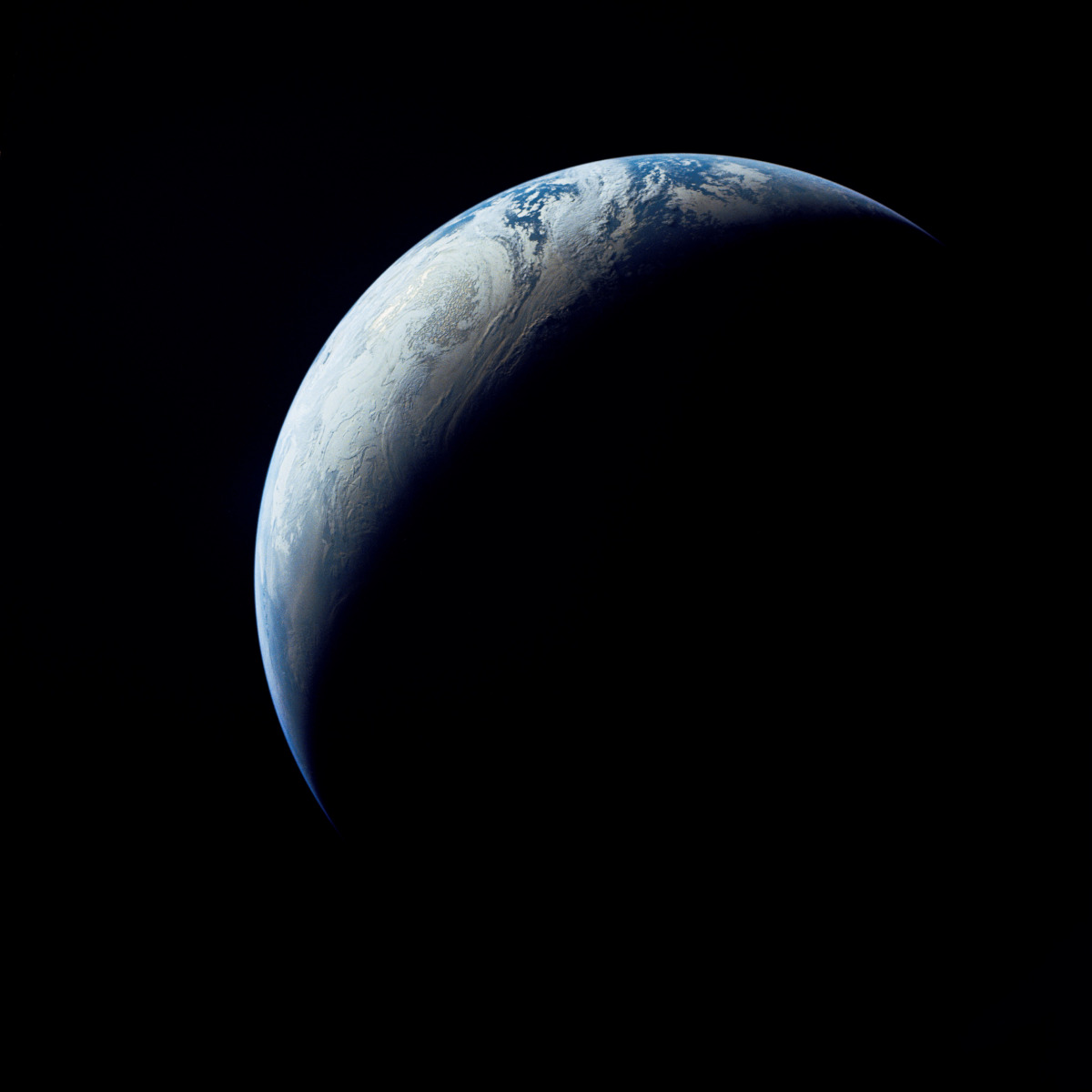 A crescent of Earth as seen from the unmanned Apollo 4 spacecraft in 1969
