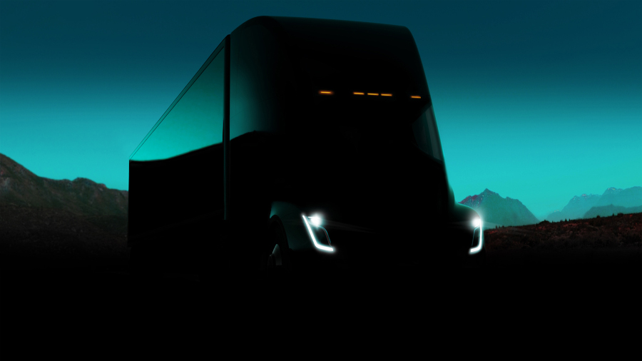 a Tesla semitruck hidden in the shadows with a picturesque mountainous background
