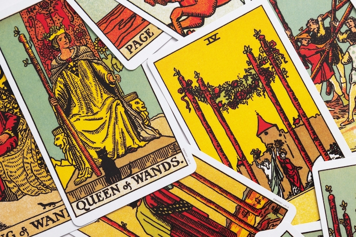 tarot cards sprawled out on a surface