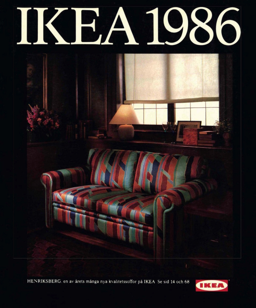 the cover of IKEA's 1986 catalog; it has a vintage look that aged well; features an image of a dark living room with a colorful, patterned couch at its center; all on a black background