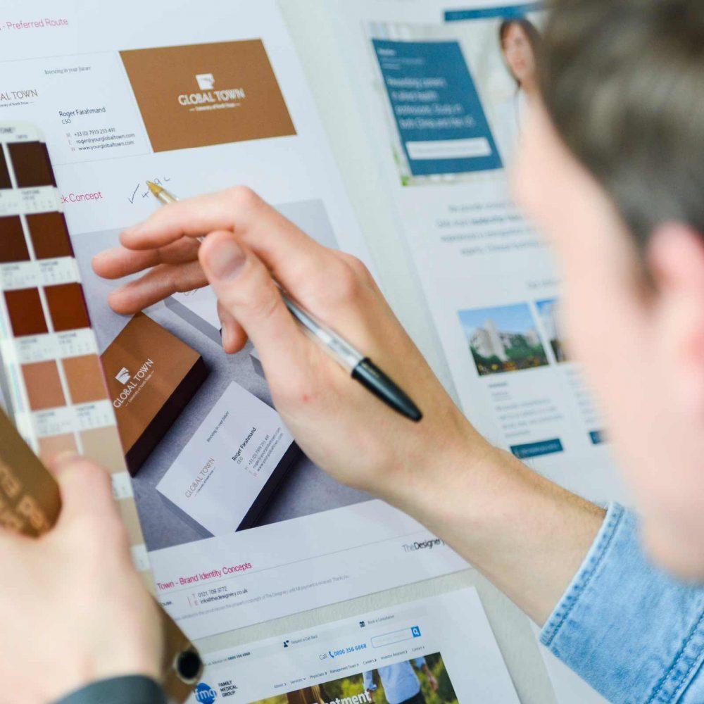 James Newland working on branding design campaign.