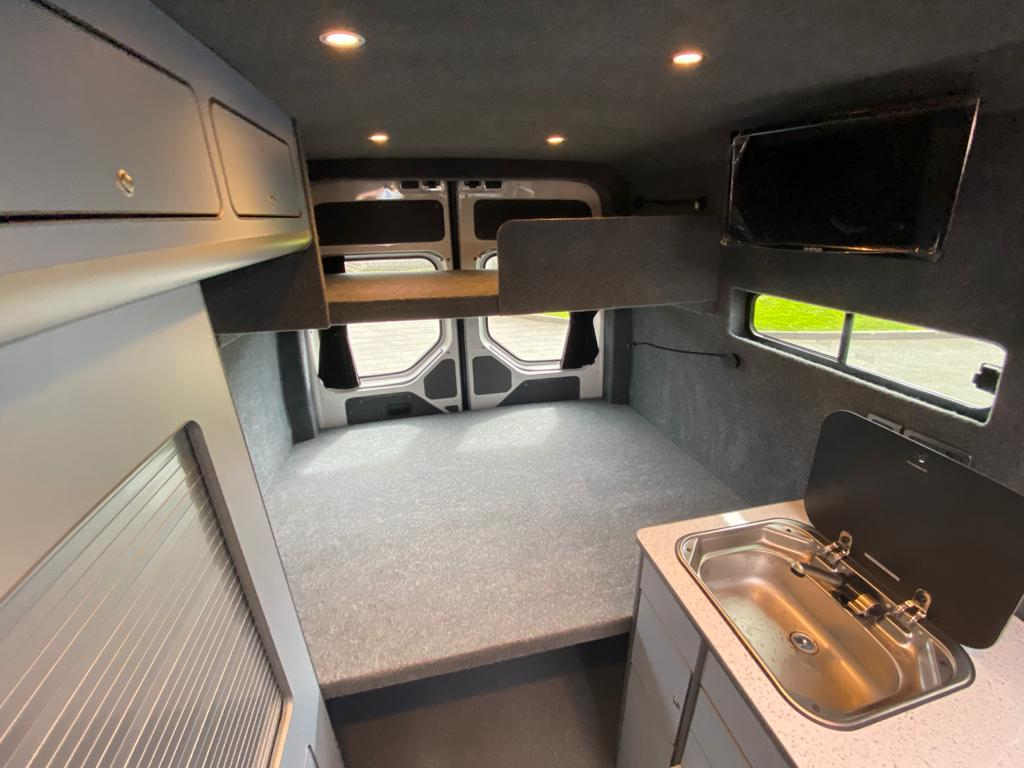 Wall mounted TV in a campervan
