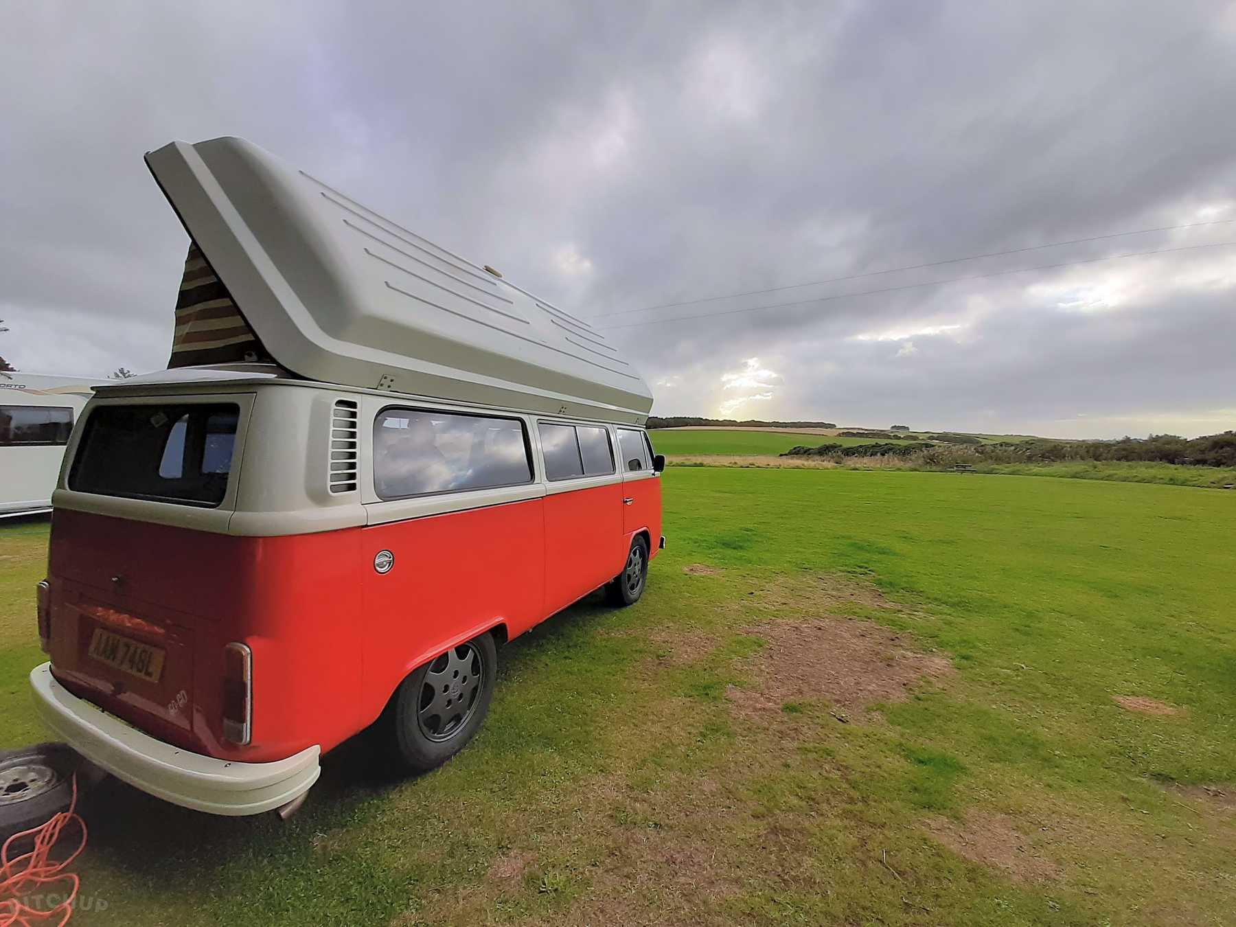 red vw transporter parked at East Balthangien campsite