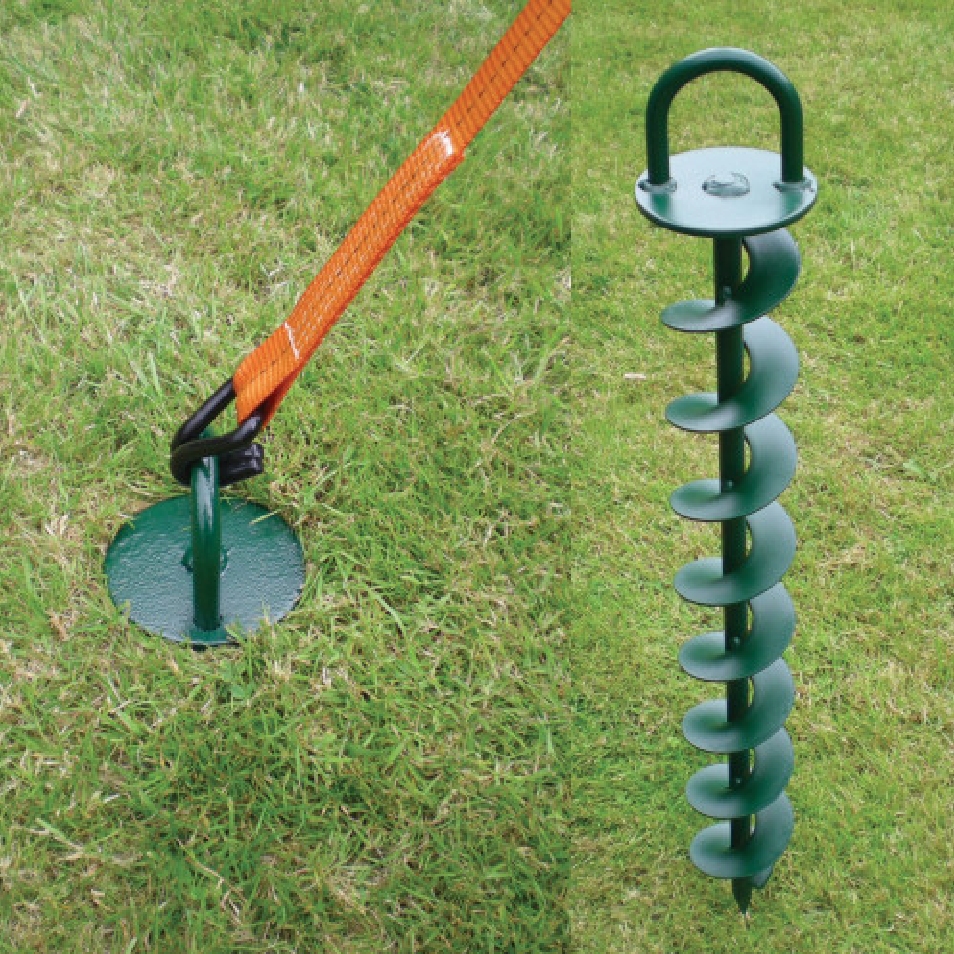 a green screw in ground hook on grass