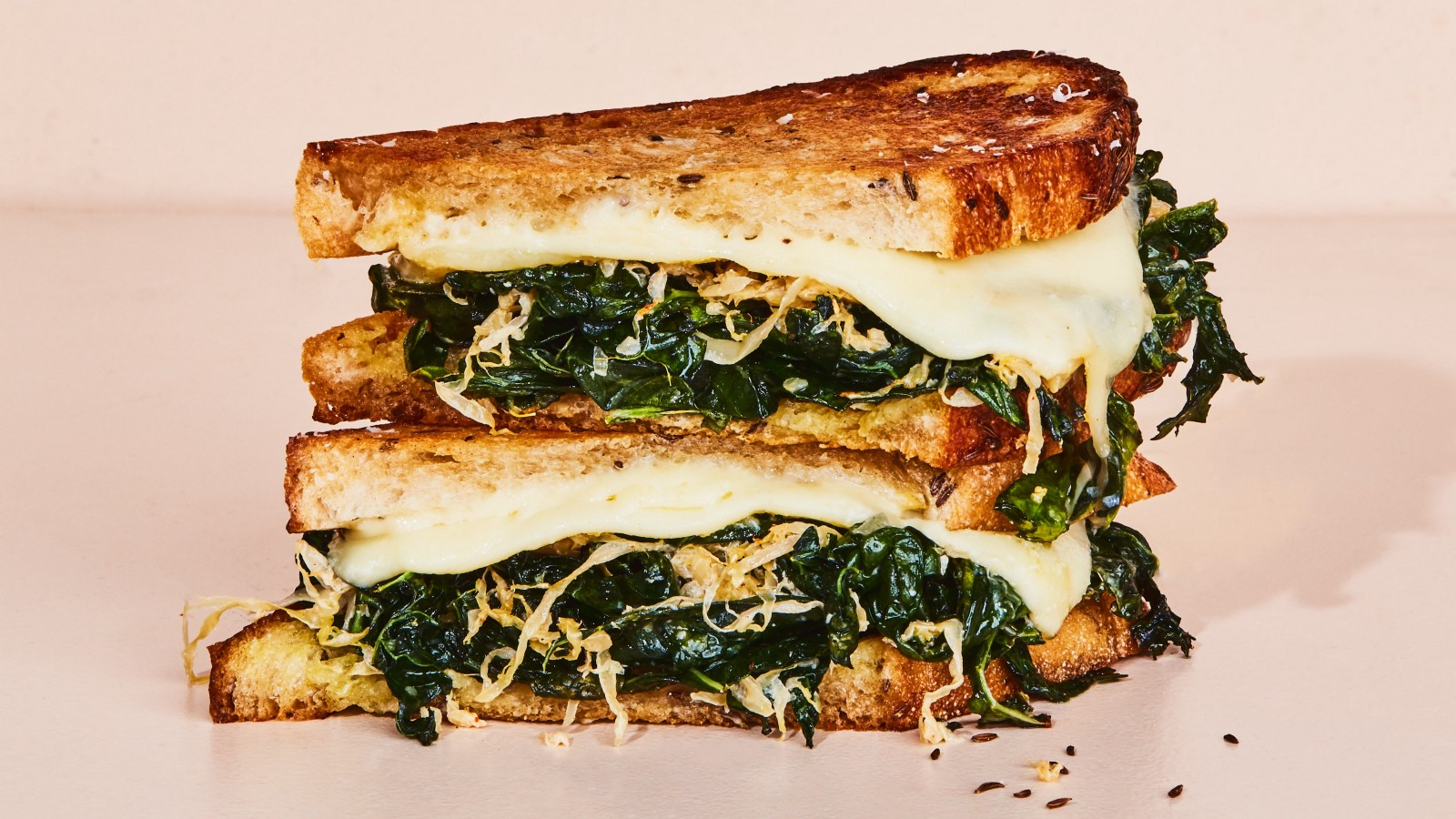 Kale Reuben from Bon Appetit. Toasted sandwich with melted cheese, sauteed kale, and sourkraut.