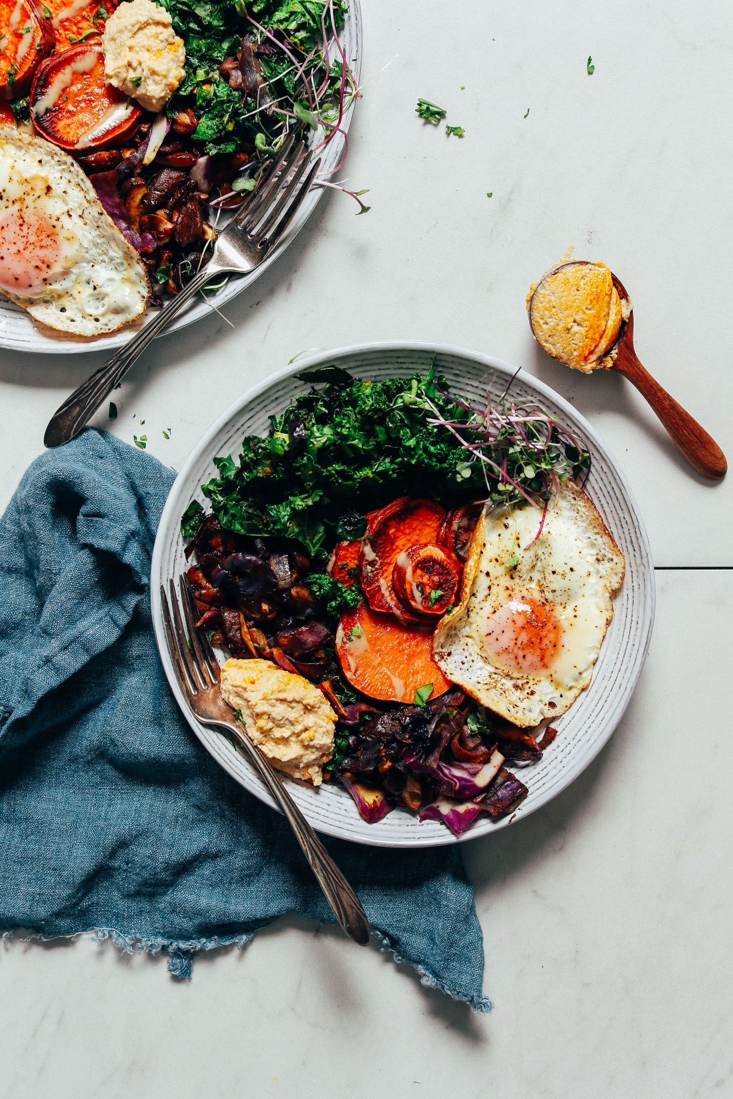 The simple but good breakfast bowl from Minimalist Baker with eggs, sweet potatoes, kale, mushrooms, and hummus.