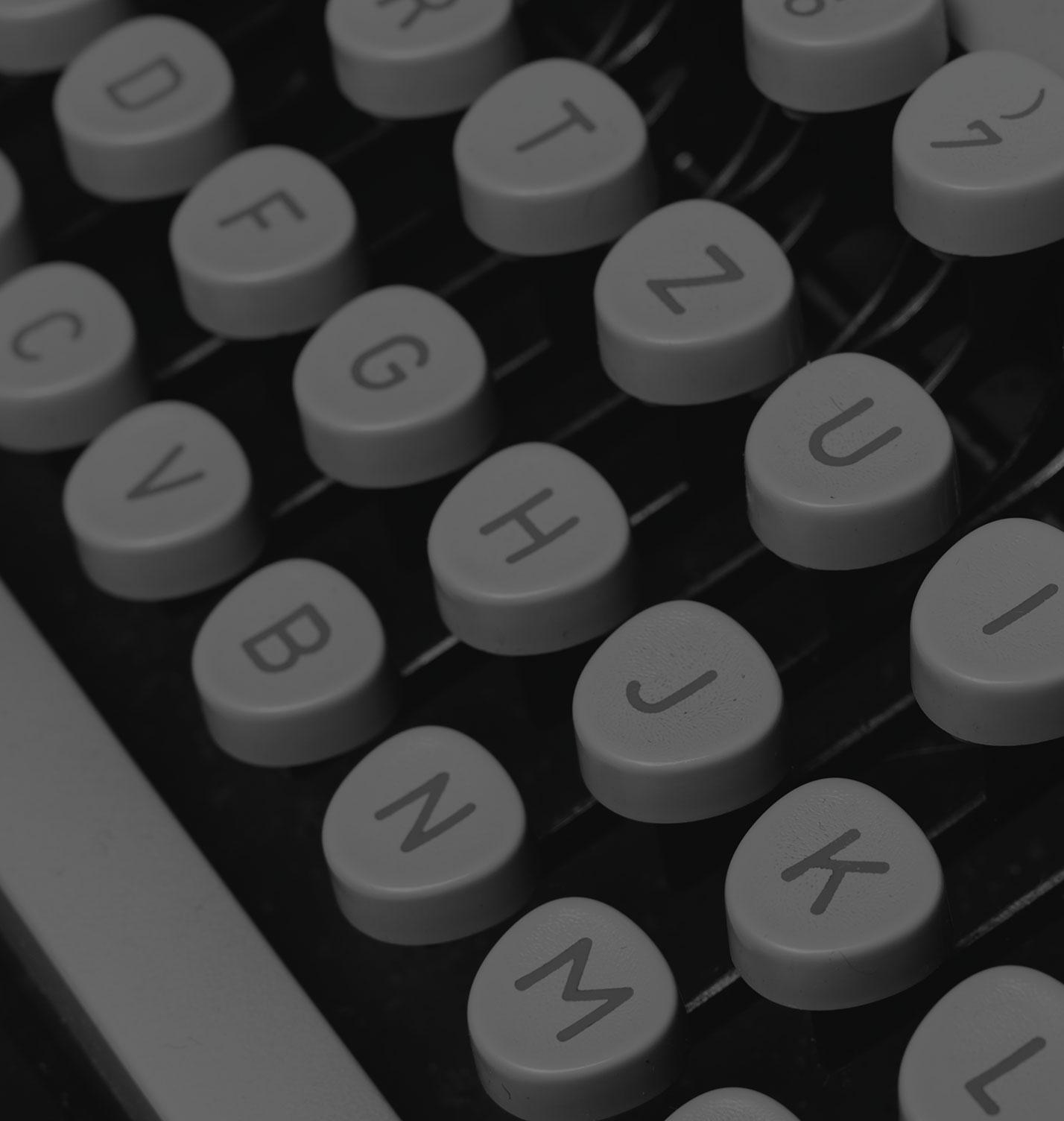 Black and white image of keys on a typewriter.