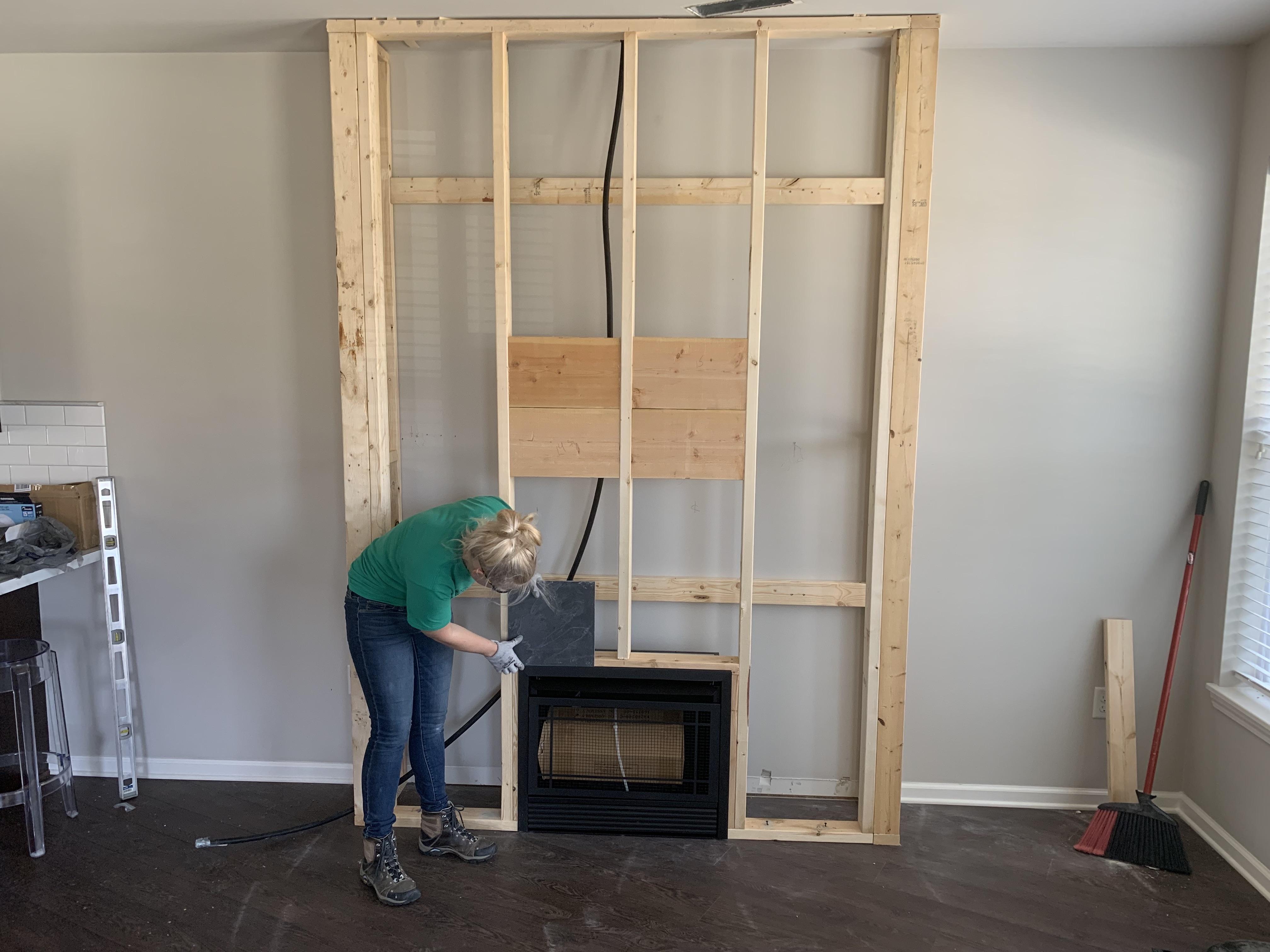 Amy framing a fireplace