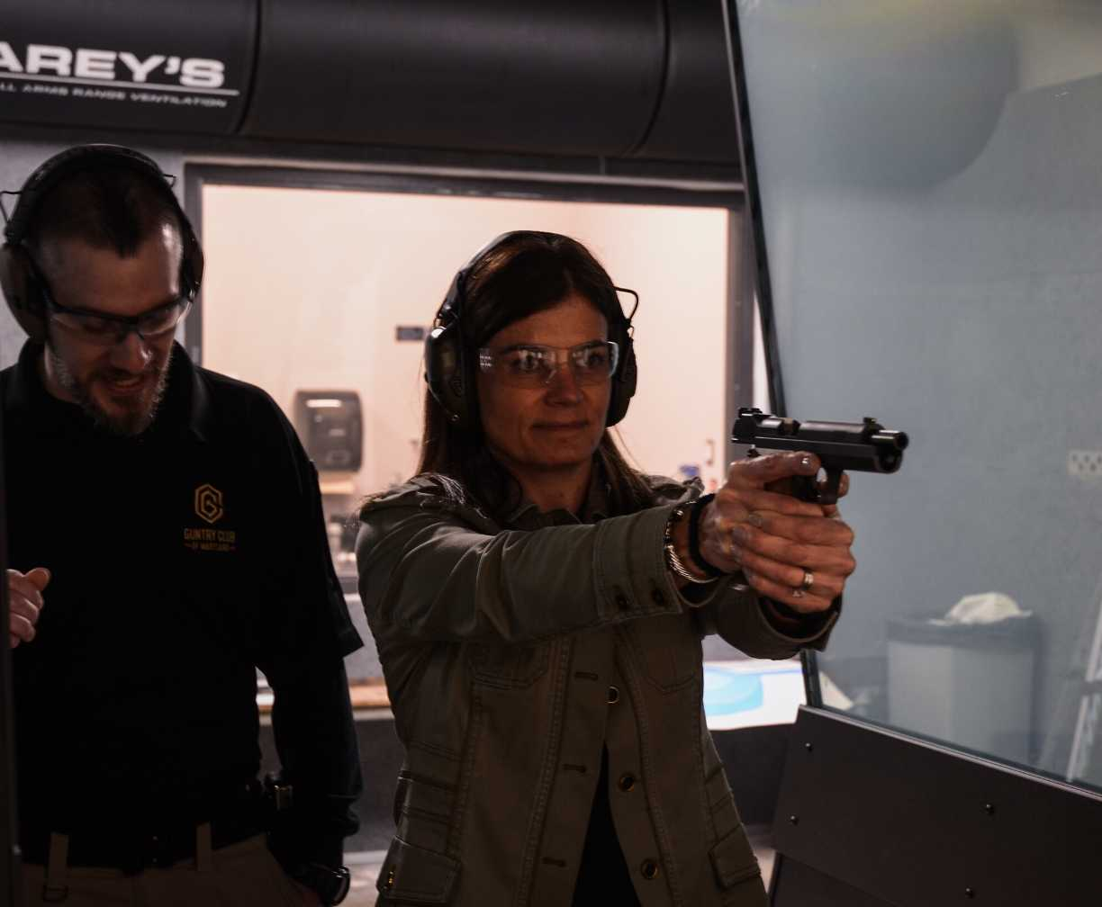 woman-learning-to-shoot-with-instructor