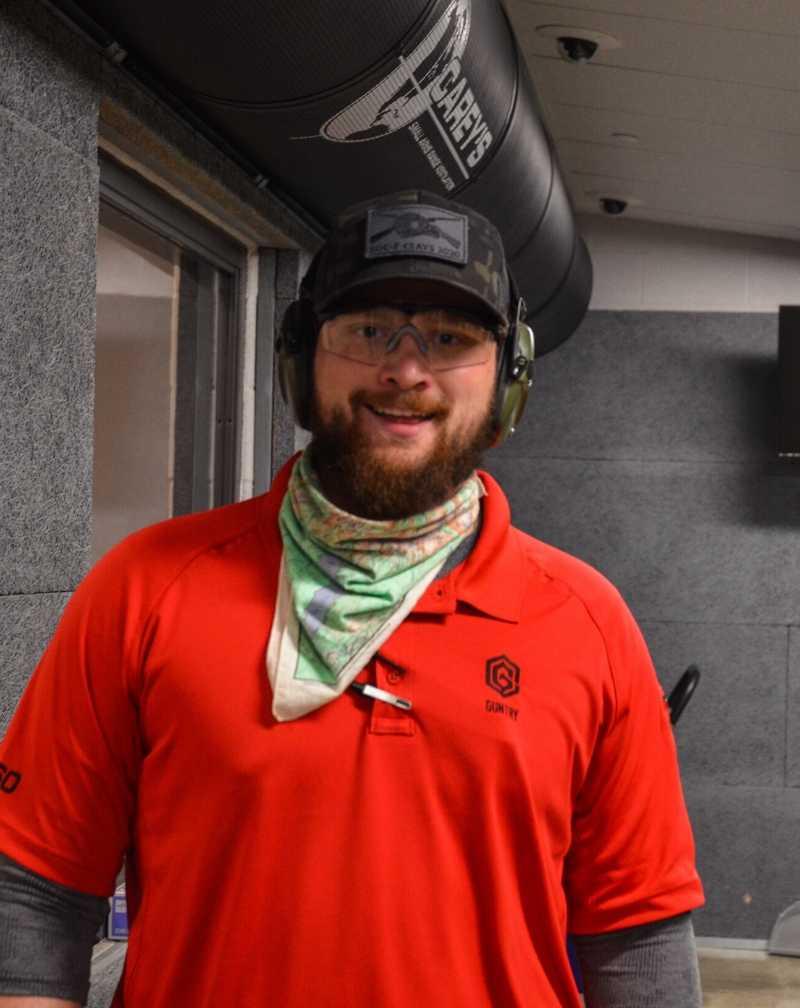 man-smiling-in-gun-range