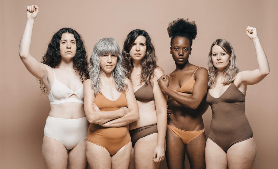 Five confident healthy women in underwear