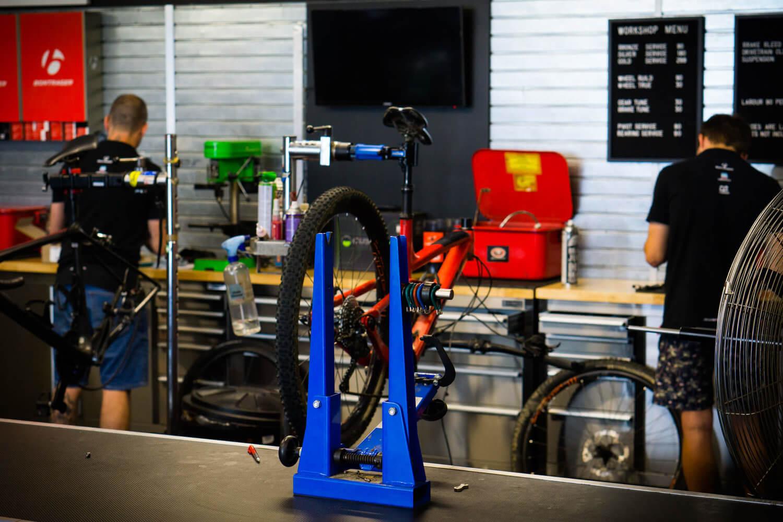 Two bike mechanics working in bike workshop in Auckland