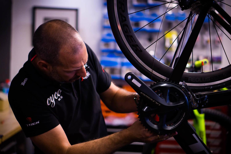 CYCO bike mechanic Darren Murray fixing a bike