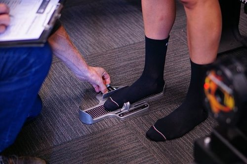 Man getting foot measured during bike fitting