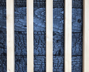Finition extérieure - badage en bois brulé