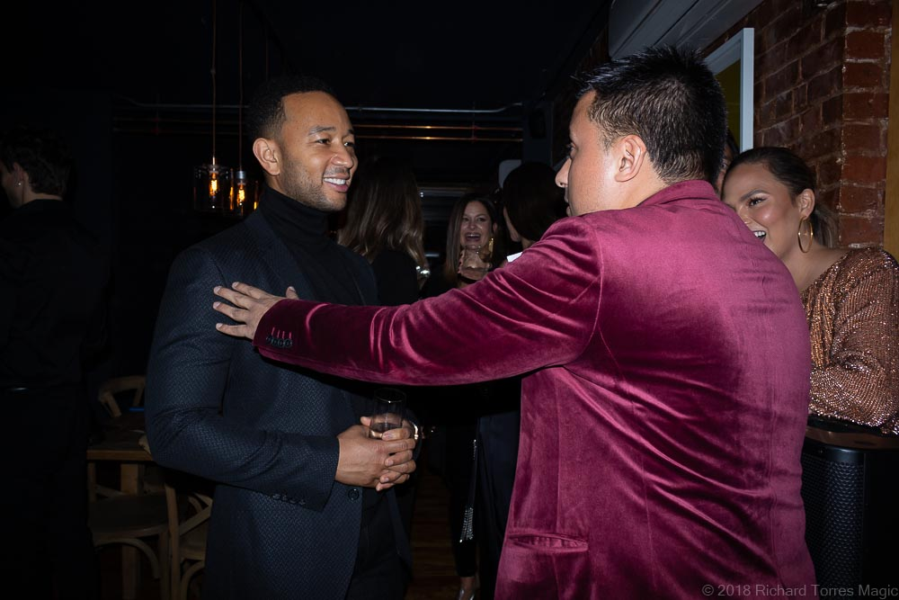 actor magician Richard Torres with singer John Legend and Chrissy Teigen