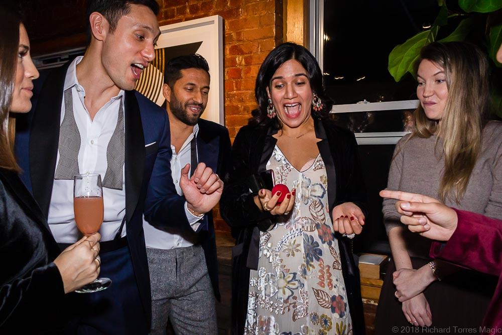 amazed woman with group holds sponge balls with nyc magician actor richard torres