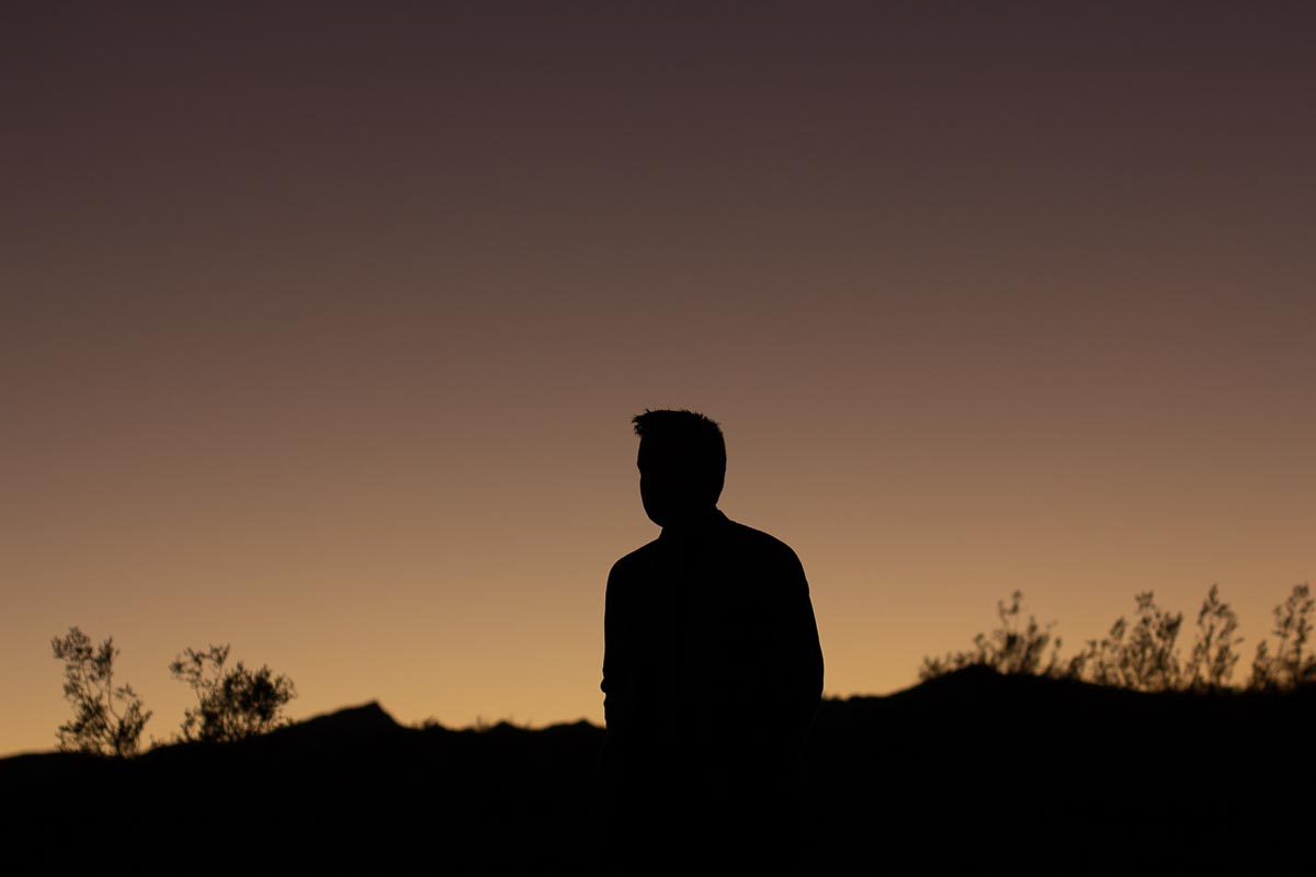 actor magician richard torres silhouette in desert
