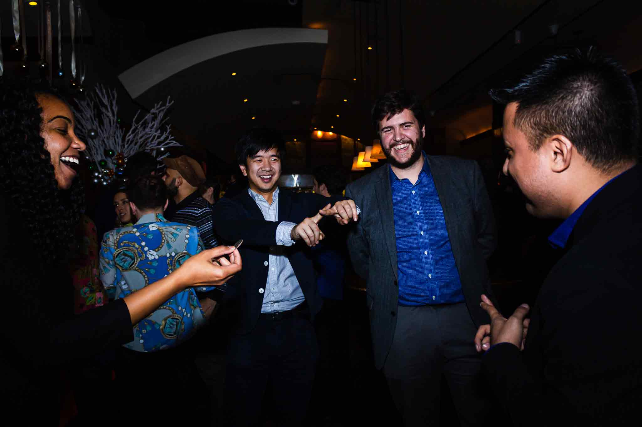 guy-makes-cross-with-fingers-smiling-guests-nyc-magician-richard-torres_web