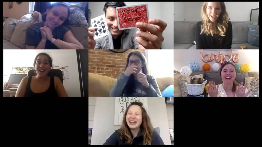 Group of women reacting to magic by Richard Torres through a webcam