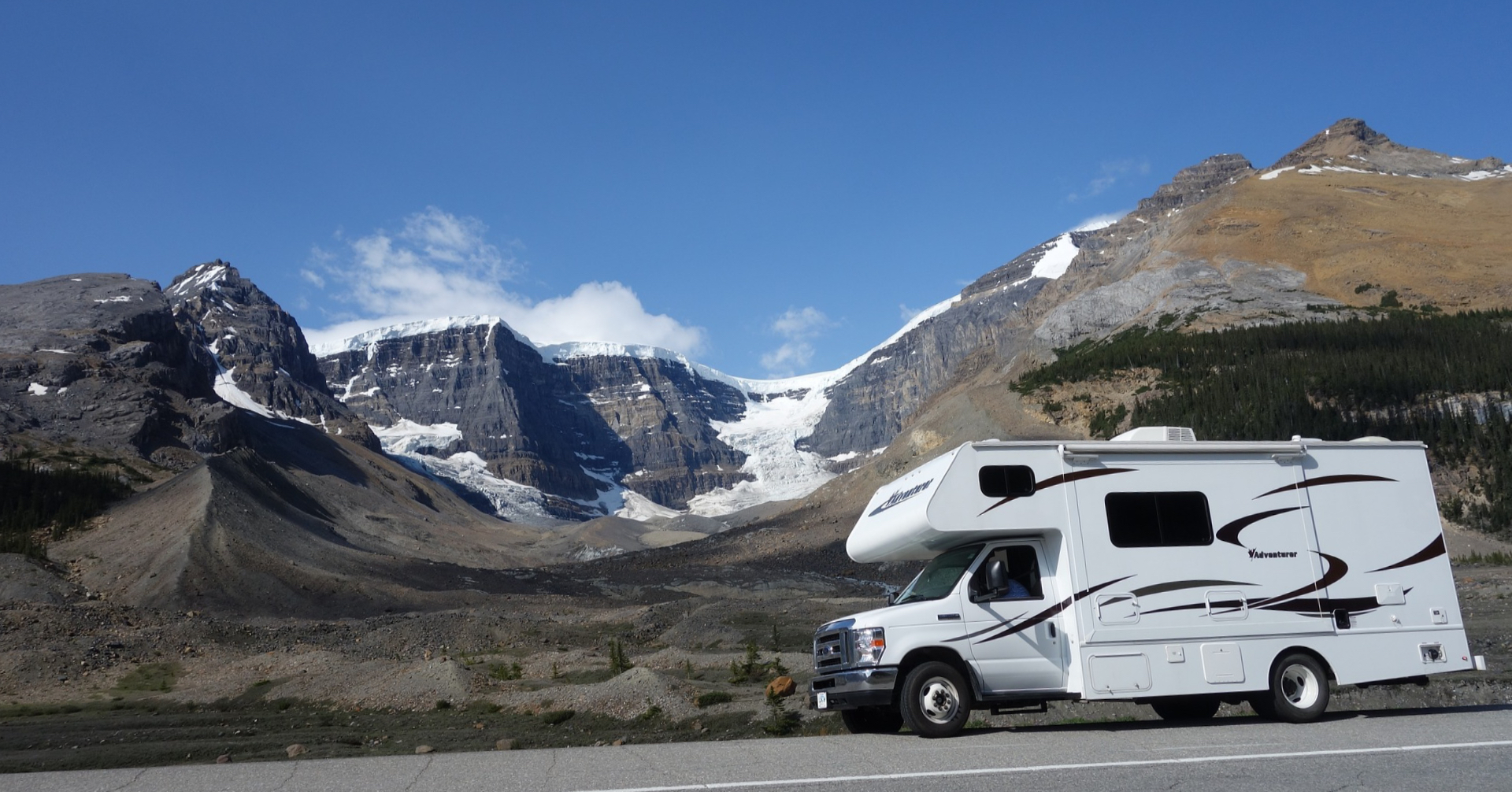 Class C motorhome with a view of the mountains.