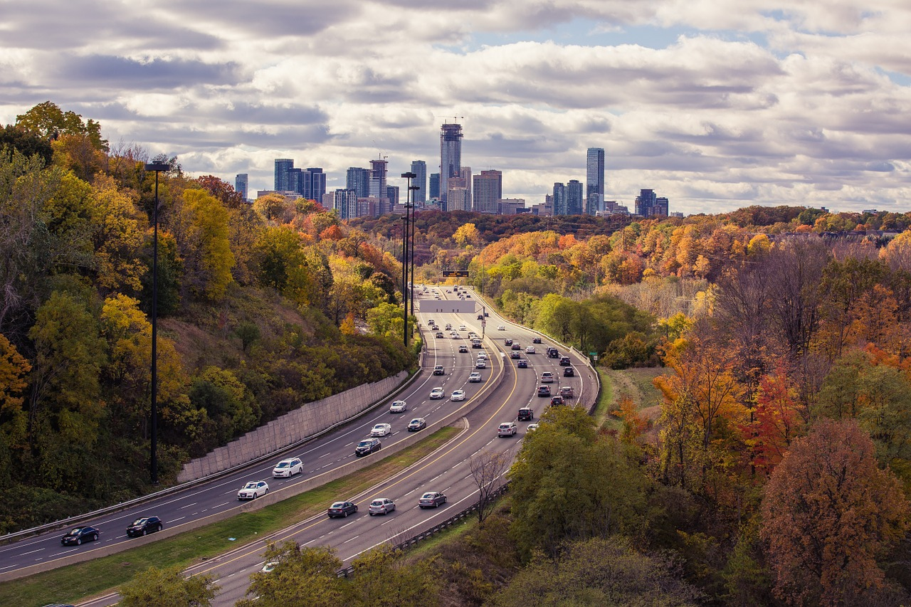Highway traffic heading toward a city