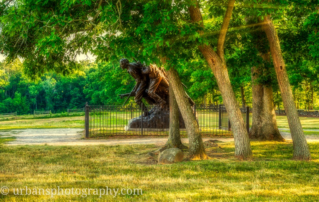 North Carolina Monument at Gettysburg with trees leaning the same as the monument.