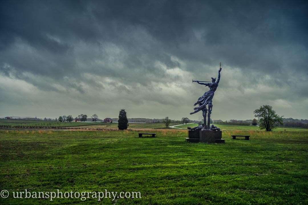 Storm clouds rolling past the Louisiana Monument.
