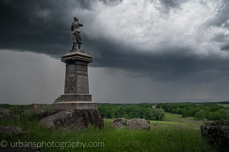 Below Little Round Top Summit the 155th PA Monument stands watching a storm roll in.