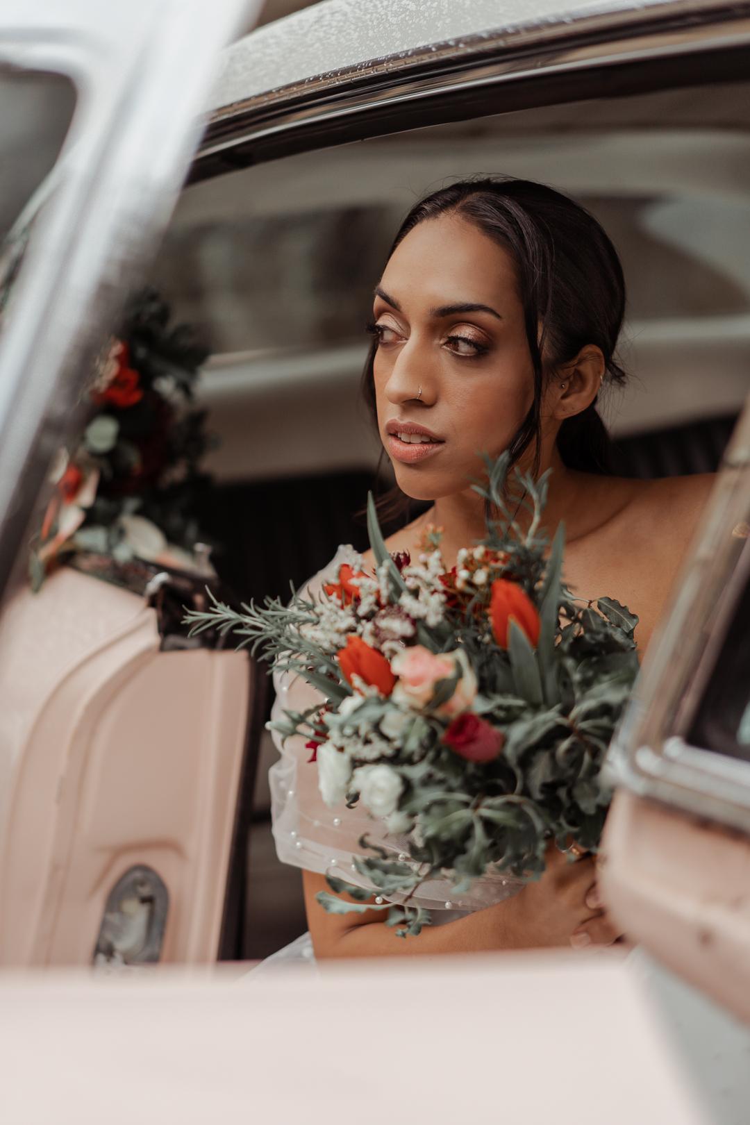 Bride in pink cadillac