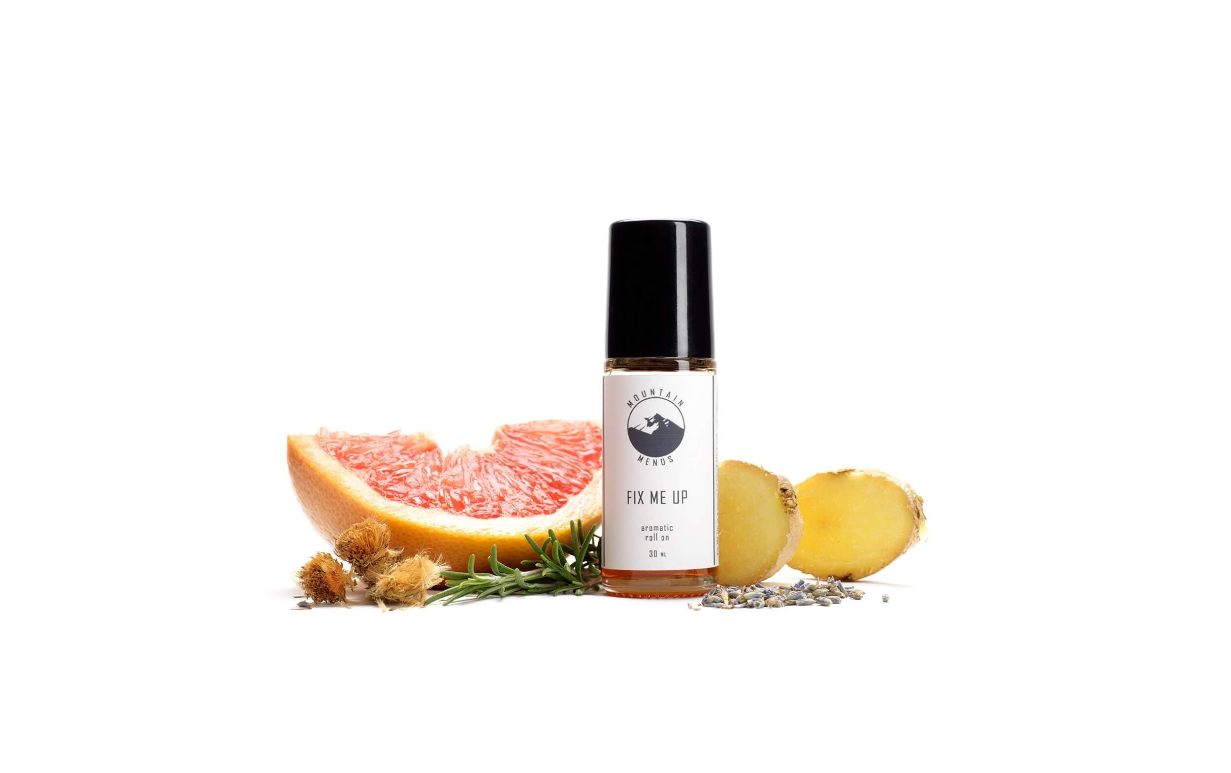 essential oil bottle with mountain mends logo surrounded by a blood orange and ginger and rosemary
