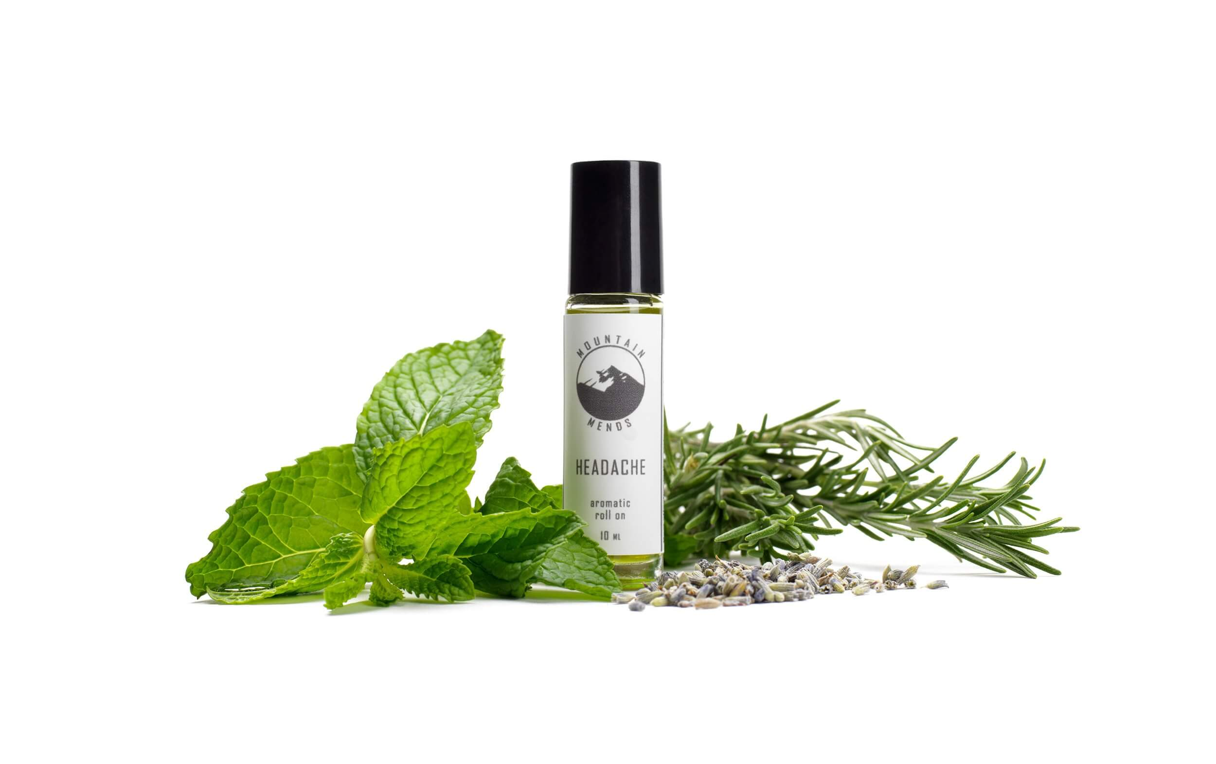 essential oil bottle with mountain mends logo surrounded by mint leaves and rosemary