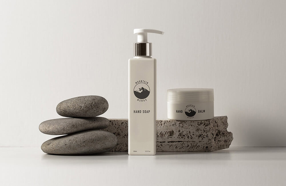 Packaging shot of a bottle of hand soap and hand balm from mountain mends