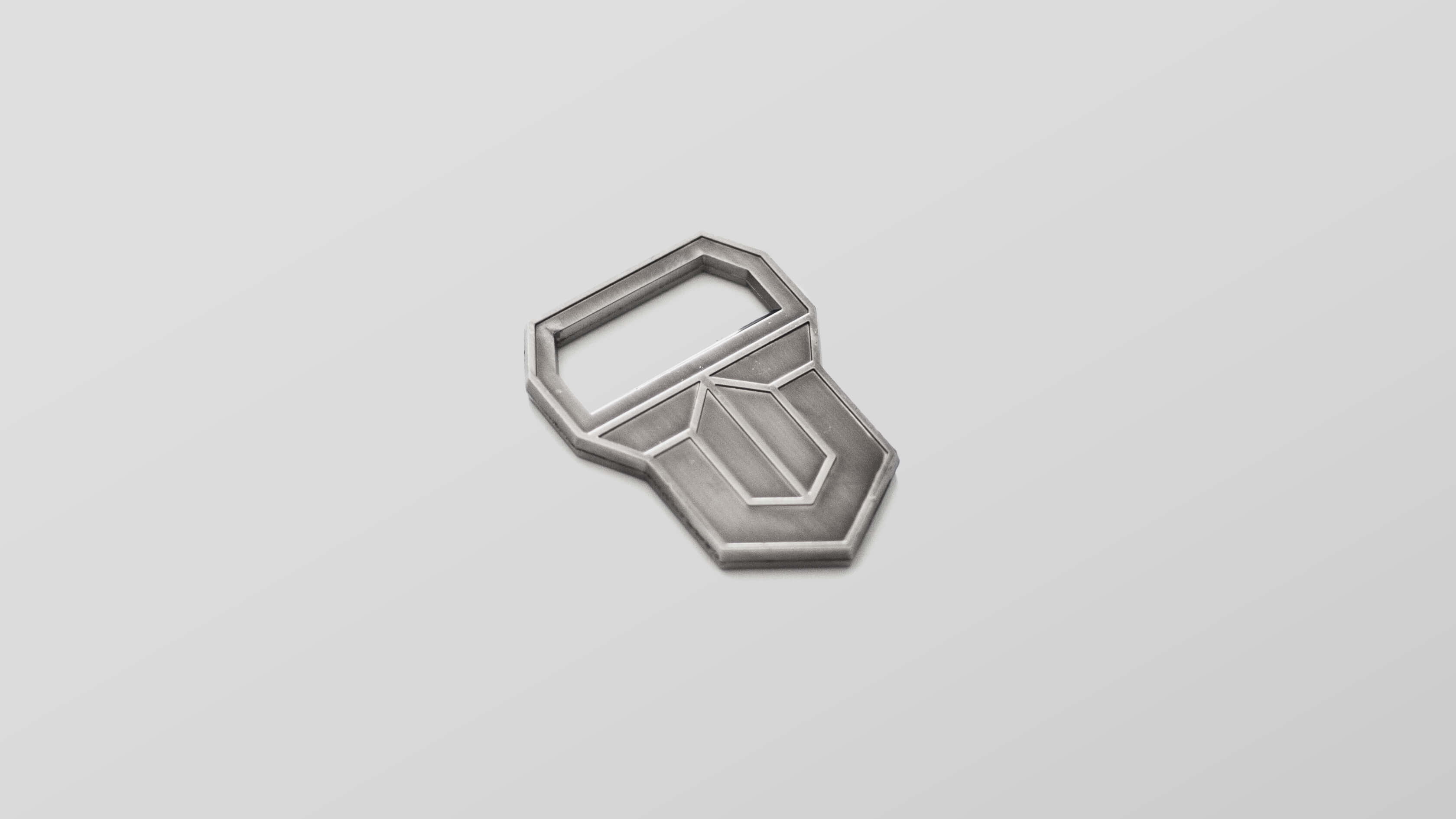 bottle opener in the shape of tjurens logo