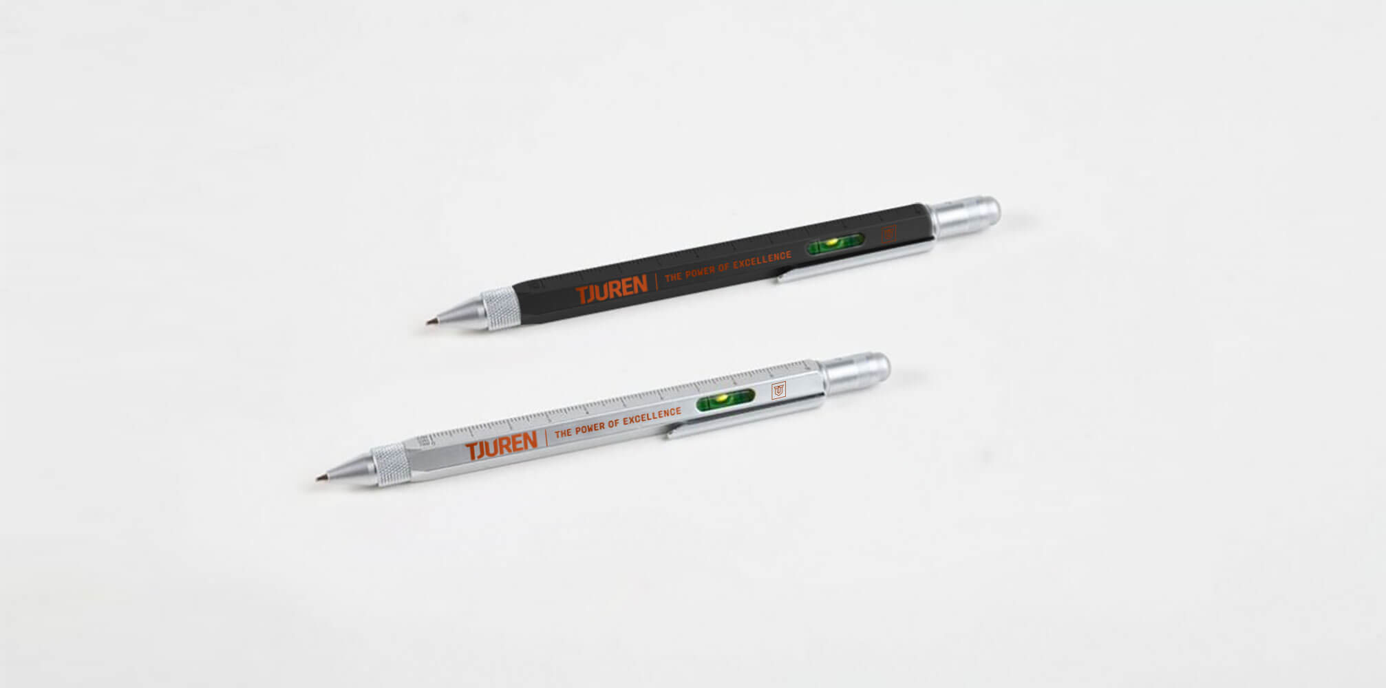 Two pens with tjurens branding printed on them.