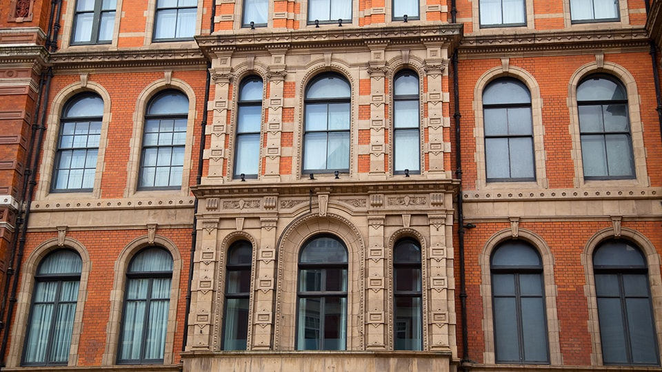 Orange bricked building with aluminium framed windows