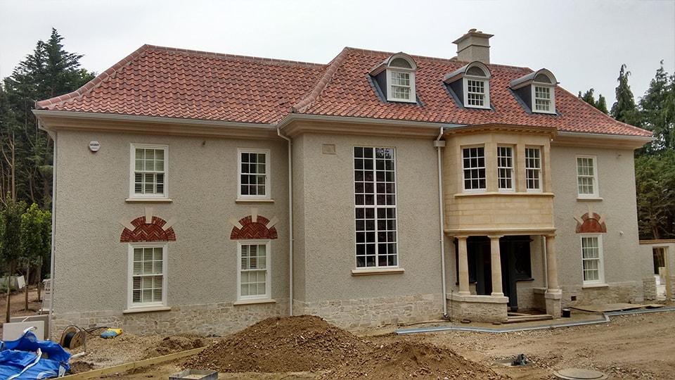House under development with wooden sash windows