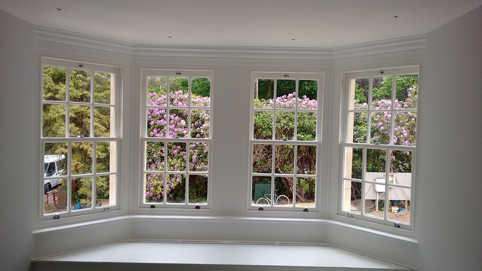 Interior point of view from a house looking at sash windows
